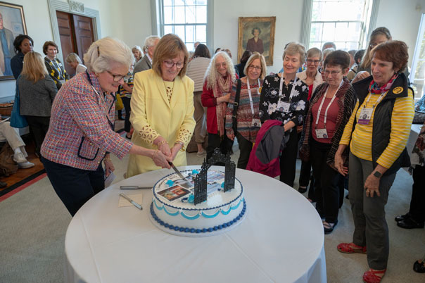 President Kathleen McCartney and Grécourt Society chair Pam Henrikson '62 cut the society's 25th anniversary cake at reunion in May 2019. Jim Gipe Photographer - Pivot Media